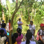 explaining how to start a food forest to farmers from KinderHome Foundation